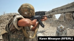Nagorno-Karabakh -- An Armenian soldier on frontline duty near Mataghis village, 20Jul2012