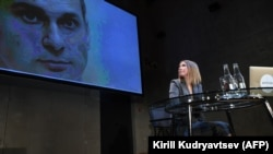 Ksenia Sobchak looks at a picture of Ukrainian prisoner Oleh Sentsov at her press conference in Moscow on October 24.