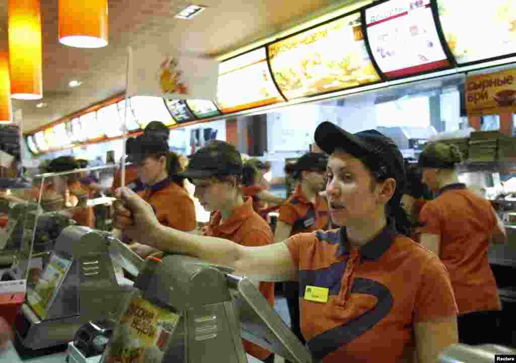 Staff attend to customers at a McDonald's restaurant in Moscow.