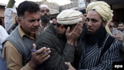 Relatives of one of the victims killed in a suicide attack on a National Database and Registration Authority (Nadra) office, react outside a hospital in Mardan, Pakistan on December 29.