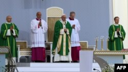Pope Francis leads an open-air Mass at Santakos Park in Kaunas on September 23.