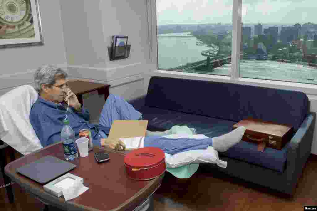 U.S. Secretary of State John Kerry speaks with National Security Adviser Susan Rice from his room at Massachusetts General Hospital in Boston on June 9. Kerry was receiving physical therapy after surgery on a broken right leg sustained in a cycling accident in France. (Reuters/State Department)