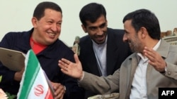 Iranian President Mahmud Ahmadinejad (right) meets with his Venezuelan counterpart, Hugo Chavez, in Tehran in October 2010.