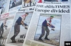 Газеты всего мира напечатали фотографию утонушего у берегов Турции сирийского мальчика, 3 сентября 2015