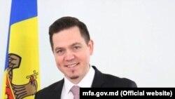 Tudor Ulianovschi (R), and Romanian ambassador Daniel Ionita, Chisinau