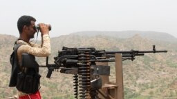 A pro-government fighter on the front line in southwestern Yemen in July 2018.