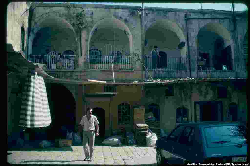 A courtyard in Aleppo photographed in 1981. Through the 1980s, with repression on the rise, an increasingly militant group, Muslim Brotherhood, carried out a series of attacks targeting the regime, including the massacre of 50 Alawite soldiers, an assassination attempt on Assad, and a bloody attempted uprising.