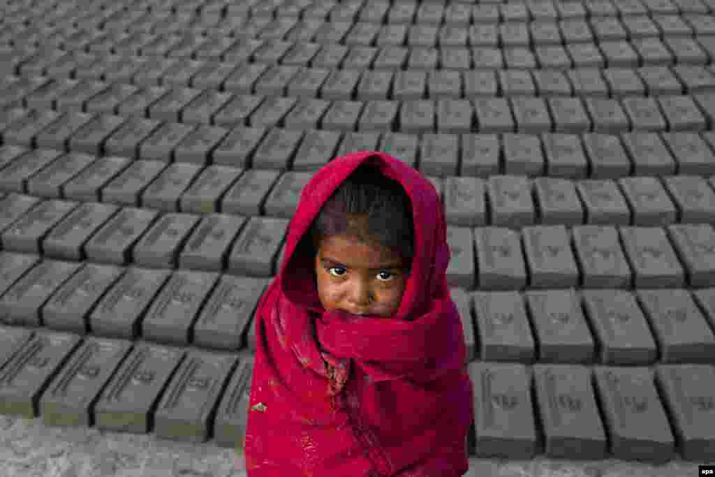 A Nepalese girl, whose parents are workers at a brick factory, in Bhaktapur on December 23. (Hemanta Shrestha/EPA)