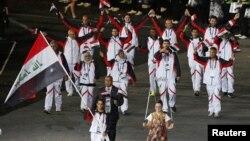 الرياضيون العراقيون اثناء استعراض فرق الاولمبياد