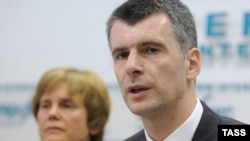 Mikhail Prokhorov (right) and his sister Irina hold a press conference in Moscow on June 4.