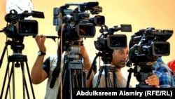 Iraq - Cameras of several Iraqi and international news agencies, Basra, 09Apr2012
