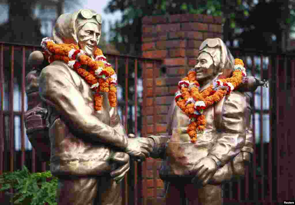 Statues in Kathmandu of Edmund Hillary and Tenzing Norgay are decorated with garlands for the 60th anniversary of their 1953 ascent.