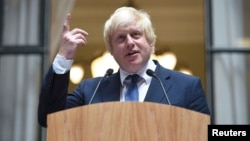 Boris Johnson addresses staff inside the Foreign Office in London on July 14, a day after being appointed Britain's Foreign Secretary.