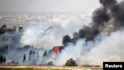 Գոլանի բարձունքներից երեւում է իսրայելա - սիրիական սահմանի անցակետում մարտերի հետեւանքով բարձրացող ծուխը, 6-ը հունվարի, 2013թ.
