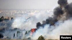 Вогонь і дим від боїв за Аль-Кунейтру, фото з ізраїльського боку лінії перемир'я, 6 червня 2013 року