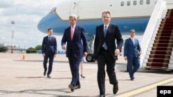 U.S. Secretary of State John Kerry walks with U.S. Ambassador to Ukraine Geoffrey Pyatt (front right) at Boryspil International Airport in Kyiv.