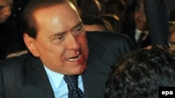 Italian Prime Minister Berlusconi: What, me worry?