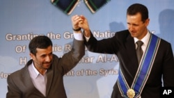 "The fall of Bashar al-Assad (right ) would be a ""disaster"" for Iran and President Mahmud Ahmadinejad."