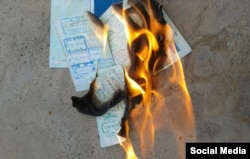 Artyom is shown first stepping on the passport and then burning it.