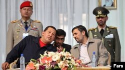 Iranian President Mahmud Ahmadinejad (right) welcomes his Venezuelan counterpart Hugo Chavez to Iran in October 2010.