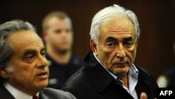Dominique Strauss-Kahn (right), director-general of the International Monetary Fund, is seen with his laywer, Benjamin Brafman, at his arraignment in New York on May 16.