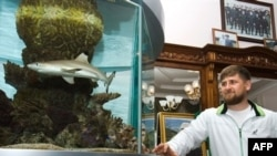 Ramzan Kadyrov stands next to an aquarium at his residence in Gudermes.