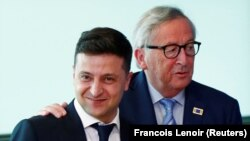 Владимир Зеленский с председателем Еврокомиссии Жан-Клодом Юнкером, Брюссель, 4 июня 2019 года.