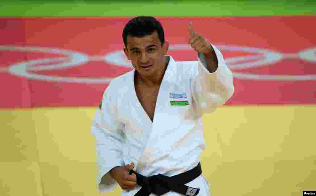 Rishod Sobirov of Uzbekistan celebrates winning a bronze medal in the men´s 66-kilogram judo final.