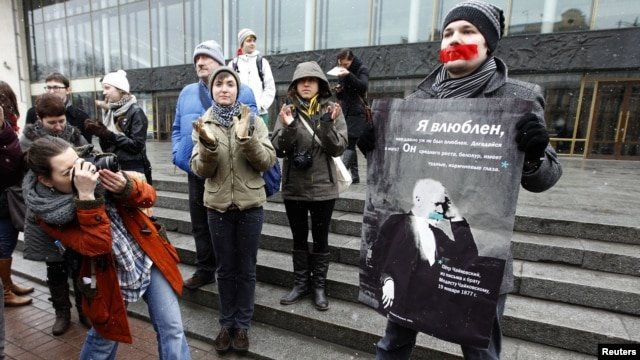 A gay-rights activist holds a placard displaying the image of 19th-century composer Pyotr Tchaikovsky during an unsanctioned protest rally to defend the rights of Russian gays and lesbians in St. Petersburg on April 7.