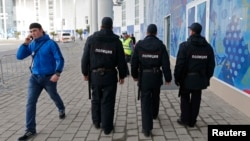 Russian security guards patrol the Olympic Park in Adler near Sochi.