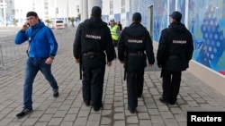 Security guards patrol near the Olympic Park ahead of the Sochi games next month.