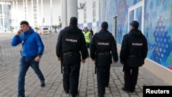 Russia -- Security guards patrol at the Olympic Park in Adler near Sochi, January 16, 2014