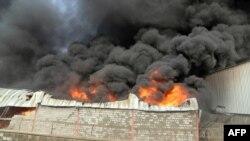 Склад гуманитарной помощи ООН в порту Ходейды после авианалета сил суннитской коалиции. Лето 2018 года