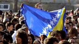 Croatia -- A girl waves a Bosnian flag in front of the prison uring the welcome ceremony for Bosnian Muslim Fikret Abdic in Pula, 09Mar2012