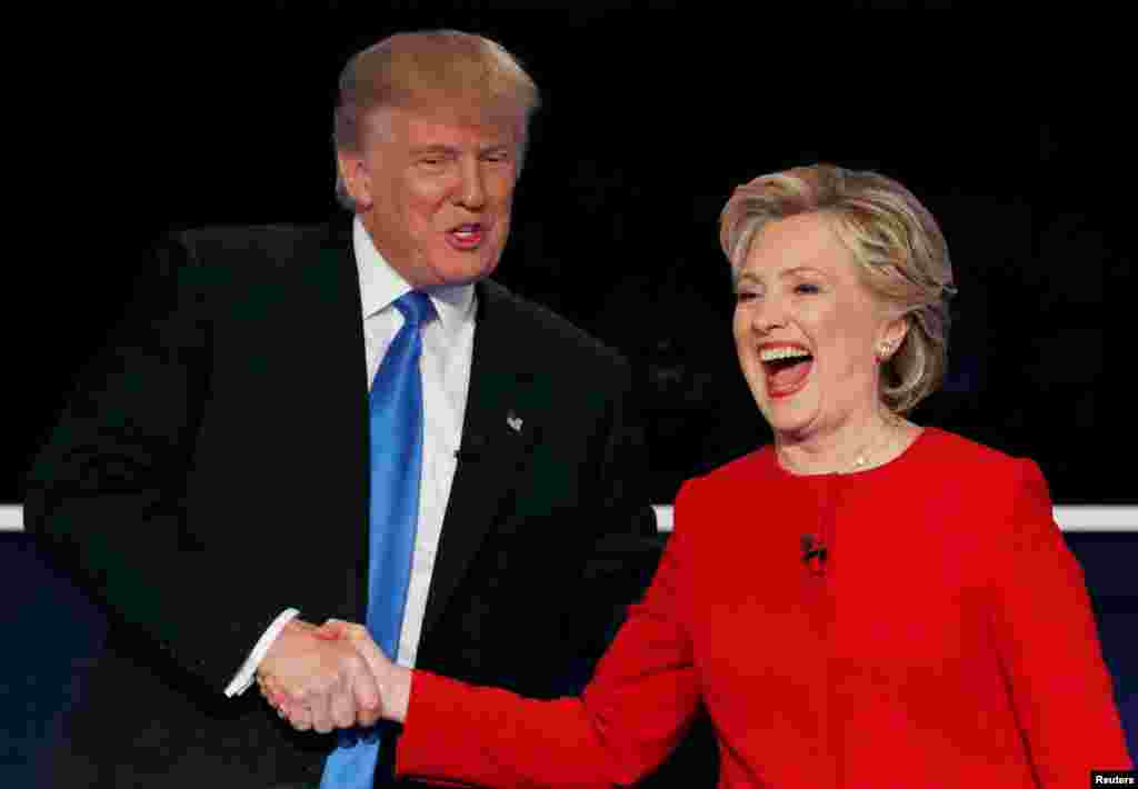 U.S. Republican presidential nominee Donald Trump (left) shakes hands with Democratic presidential nominee Hillary Clinton at the conclusion of their first presidential debate at Hofstra University in Hempstead, New York, on September 26. (Reuters/Mike Segar)