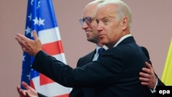 U.S. Vice President Joe Biden (right) meets with Ukrainian Prime Minister Arseniy Yatsenyuk in Kyiv on June 7.