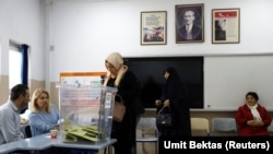 People voting in Ankara on March 31.