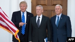 President-elect Doanld Trump poses for a photo with retired U.S. Marine General James Mattis (center) and Vice President-elect Mike Pence on the steps of the clubhouse at Trump National Golf Club in Bedminster, New Jersey, on November 19.