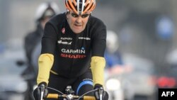 U.S. Secretary of State John Kerry rides his bike in Lausanne, Switzerland, in March.