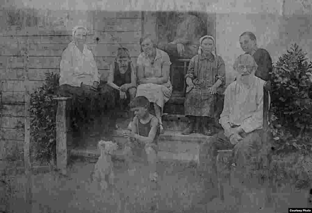 "Several participants described the ideological disconnect they felt with older relatives brought up as true Soviet believers. Kyiv-based economist Andriy Ignatov, who has published a book based on the family of his paternal grandfather, Yuriy (seated, with the dog), says he and his grandfather frequently argued about the merits of the Soviet system. ""For years, he denied there had ever been a Holodomor,"" Ignatov says, referring to Stalin's orchestrated famine in Ukraine. ""This was true even though many of his own family members died as a result of it."""