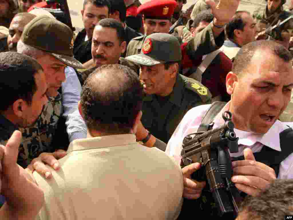 Defense Minister Mohammed Hussein Tantawi talks to antigovernment protesters in Tahrir Square.