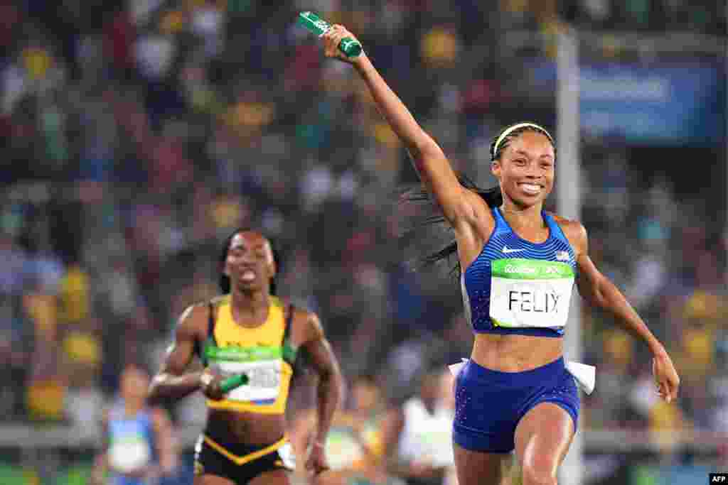 Allyson Felix of the United States celebrates as she crosses the finish line after helping her team win a record sixth gold medal in the women's 4x400 meters.