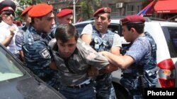 Armenia - Police detain a protester during a demonstration against traffic fines in Yerevan, 19Jun2014.