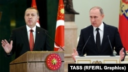 Putin and Erdogan go mano a mano.