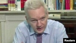 WikiLeaks founder Julian Assange speaks during a teleconference from the Ecuadoran Embassy in London on September 26.