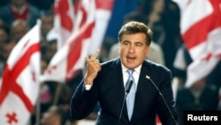 Грузия президенті Михаил Саакашвили «Біртұтас ұлттық қозғалыс» партиясы конгресінде сөйлеп тұр, Тбилиси, 5 қазан 2013 жыл.