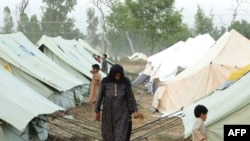 Displaced residents of Swat and Buner at a makeshift camp in Mardan on May 10