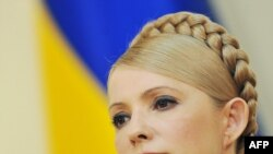 "Ukraine Prime Minister Yulia Tymoshenko called the new measure a ""death warrant"" for democracy."