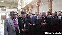 زيارة المالكي الى كنيسة سيدة النجاة