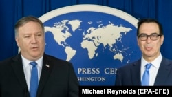 U.S. Secretary of State Mike Pompeo (left) and U.S. Treasury Secretary Steven Mnuchin announce sanctions against Iran during a news conference at the Foreign Press Center in Washington, November 5, 2018